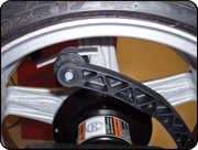 Inner Auto-Assist Data Input Arm also places tape weights behind spokes or on inner edge of wheel